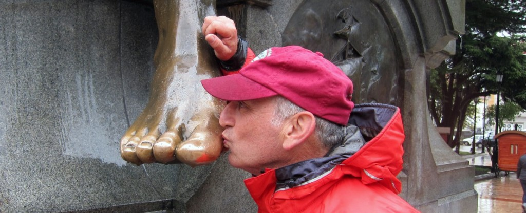 Alan Feldstein Kissing the Foot of Native Indian Statue - Punta Arenas Chile